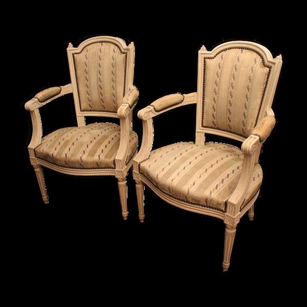 Paire de fauteuils cabriolets de style Louis XVI