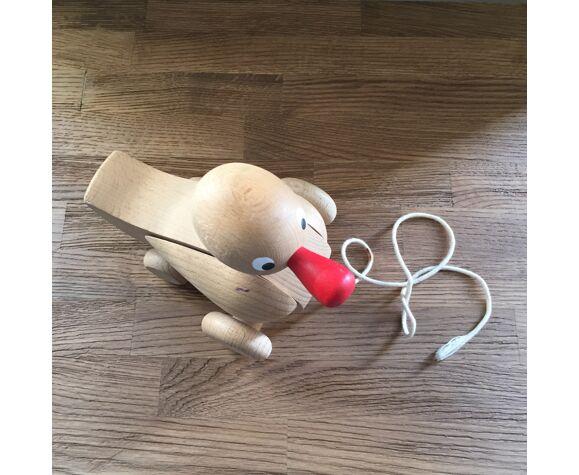 Canard à roulettes en bois brut