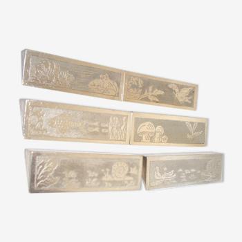 Serie de 6 porte couteaux en métal argenté