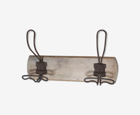 Old vintag coat rack2 metal hooks with mascarons (faces) on beech wood plate