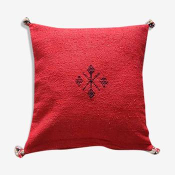Coussin marocain rouge à pompon en coton