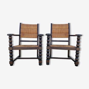 Paire de fauteuils en paille et chêne dans le goût de Charles Dudouyt, France, 1950