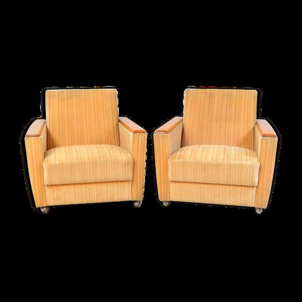 Paire de fauteuils jaunes vintage