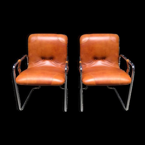 Paire de fauteuils en cuir gold années 70