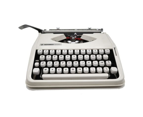 Machine à écrire Hermes Baby beige cursive révisée ruban neuf