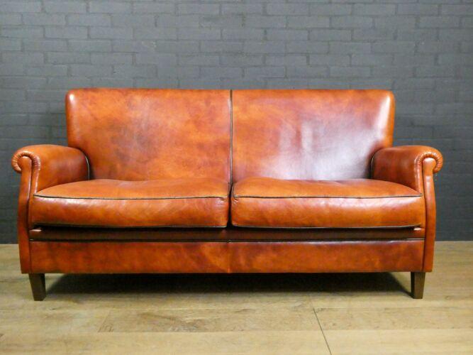 Vintage sheepskin leather 2-seater sofa in brown with dark trim