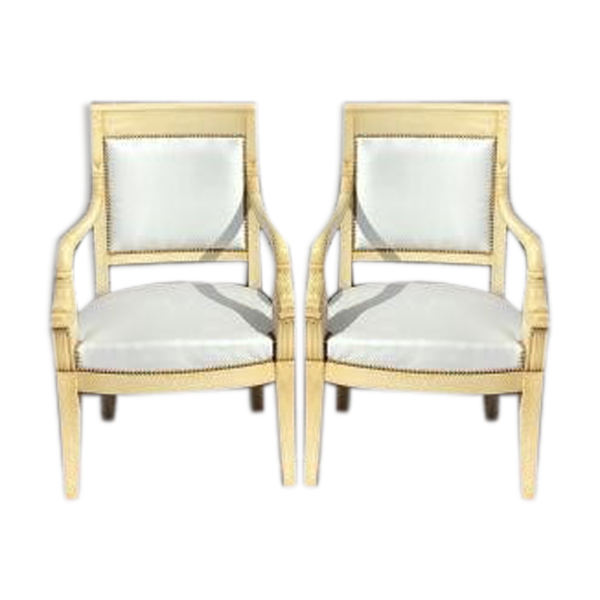 Paire de fauteuils aux dauphins d'époque empire en bois laqué