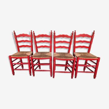 Suite de 4 chaises rouges en bois et paille