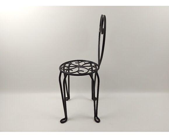 Chaise porte-plantes en fer forgé