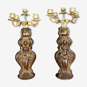 Paire de torchères en antimoine et bronze doré.