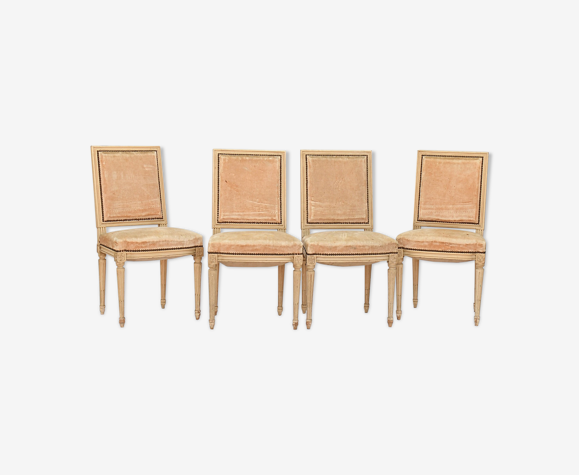 4 chaises en bois laqué blanc de style Louis XVI