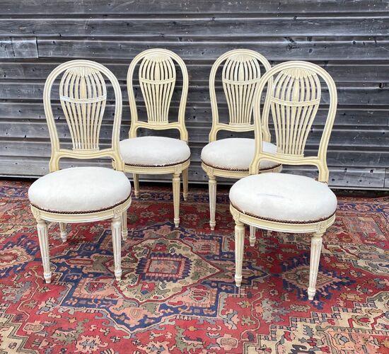 Suite de quatre chaises à dossier montgolfière de style Louis XVI