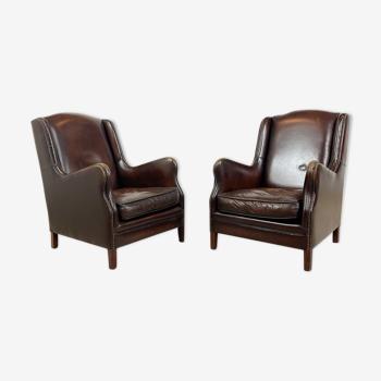 Ensemble de deux fauteuils en cuir de mouton vintage brun foncé