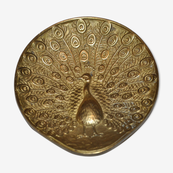 Brass pocket with peacock decoration