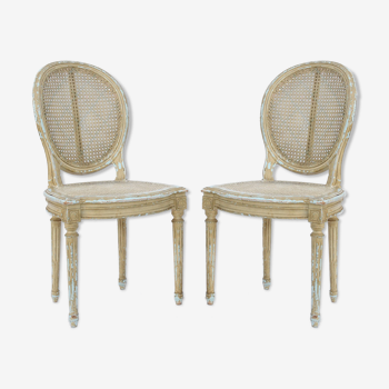 Paire de chaises cannée et laquée blanc