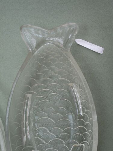 Two glass raviers in the shape of a fish
