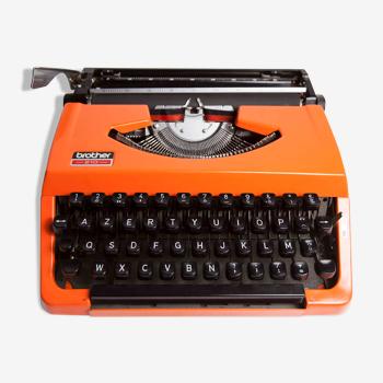 Machine à écrire brother 210 orange, révisée et ruban neuf