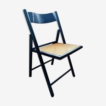 Chaise pliante noire cannée