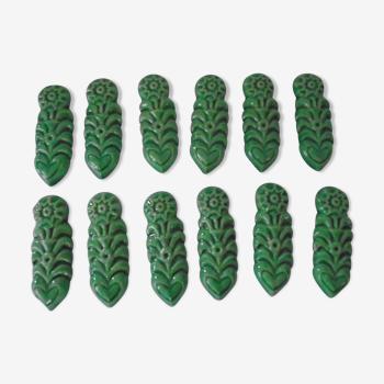 12 porte-couteaux céramique verte des années 60 vintage motifs soleil & fleurs