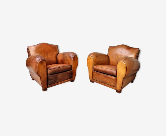 Paire de fauteuils club en cuir