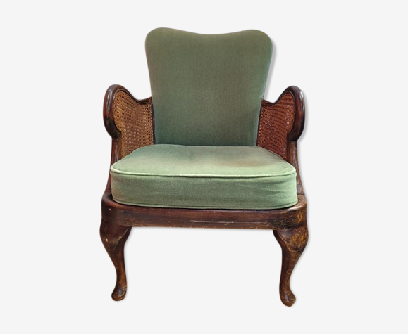 Green armchair with canage