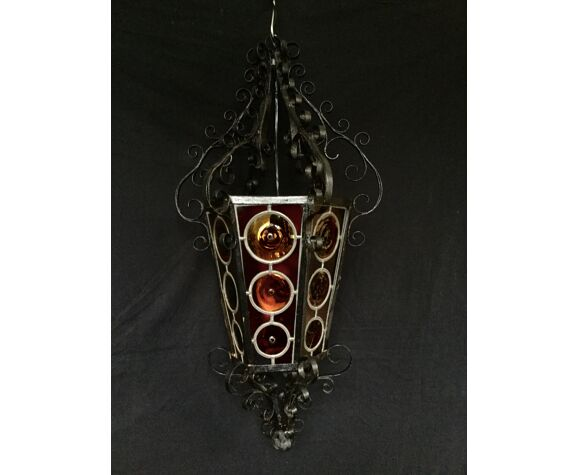 Wrought iron lantern and stained glass windows