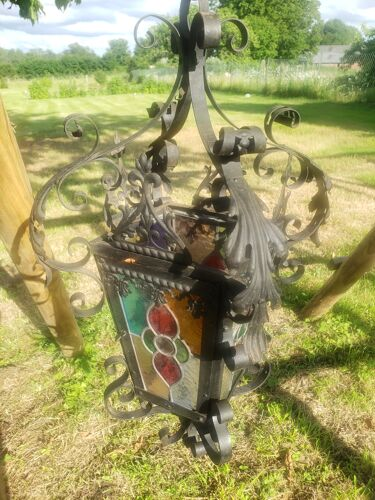 Wrought iron garden lantern and stained glass windows