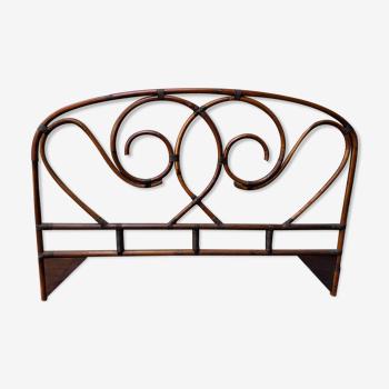 Tête de lit arabesques en rotin