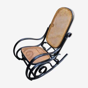 Rocking chair noir avec cannage
