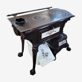 Cuisinière sougland en fonte émaillée ancienne