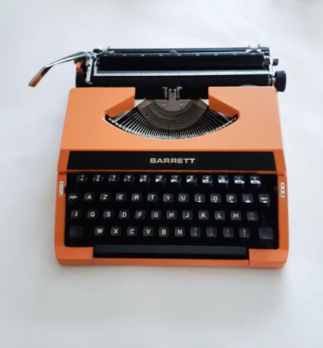 Machine à écrire orange fonctionnelle