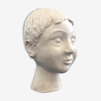 Plaster girl's head