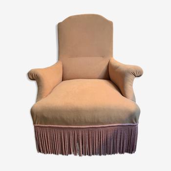 fauteuil crapaud en velours jaune et passementerie rose