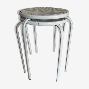 Pair of perforated metal stools at the end of 1970