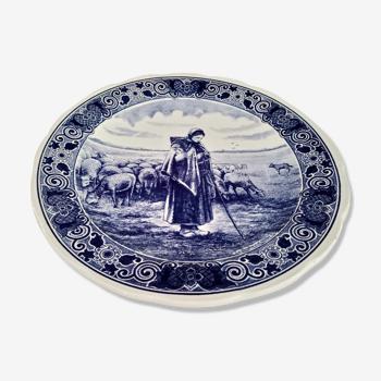 Plat rond creux Delfts décor bergère et ses moutons