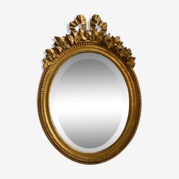 Miroir biseauté en bois doré Louis XVI 70x50
