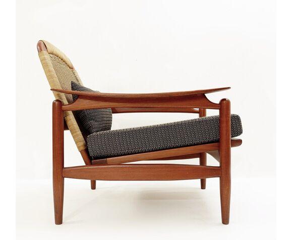 Fauteuil en teck et osier Danemark 1960s