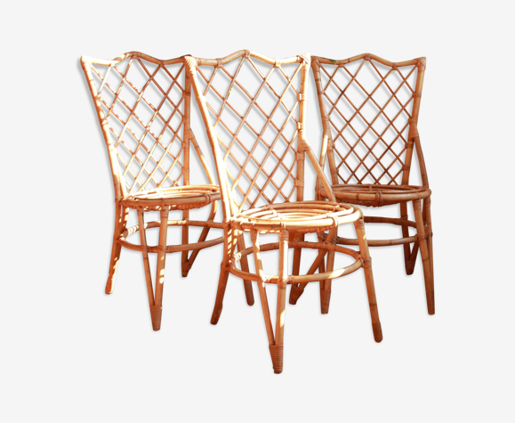 Trio of chairs in rattan Louis Sognot 50 60