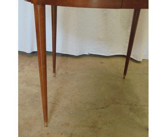 Table ronde en acajou avec 4 rallonges des années 50