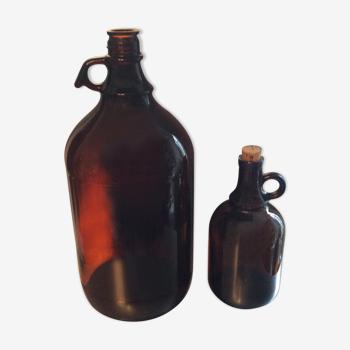2  bonbonnes vintage en verre ambré