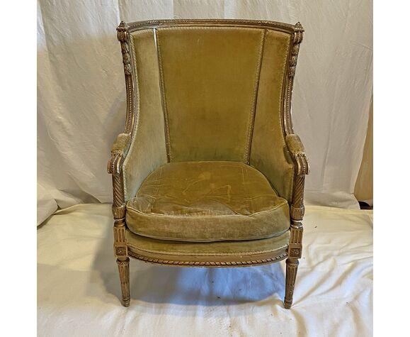 Fauteuil de style Louis XVI en bois doré