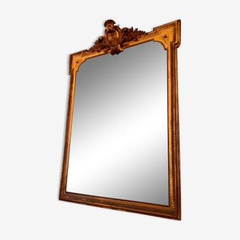 Grand miroir XIX ème en bois et stuc doré style Louis XVI