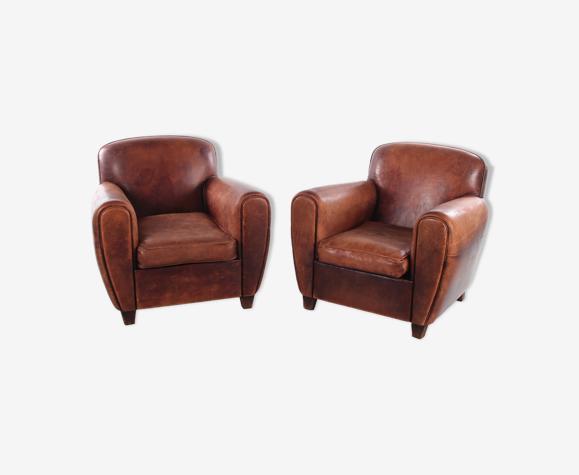 Paire de fauteuils en peau de mouton
