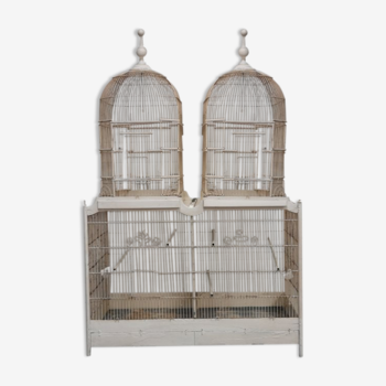 Double cage with birds in wooden metal white rectangular bell tower 1910