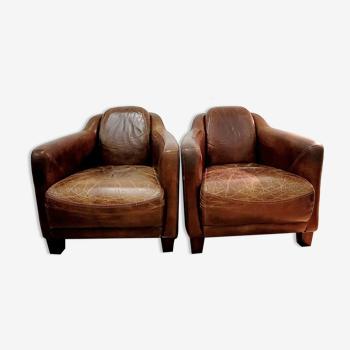 Paires de Fauteuils club en cuir vintage