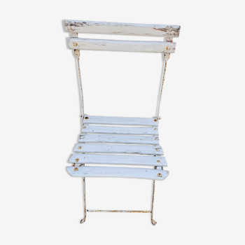 Wooden slatted garden chair with wooden slats and iron feet