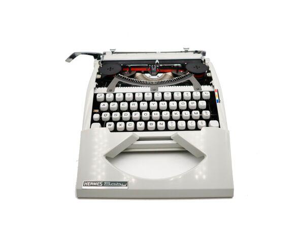 Machine à écrire Hermes Baby blanche révisée ruban neuf