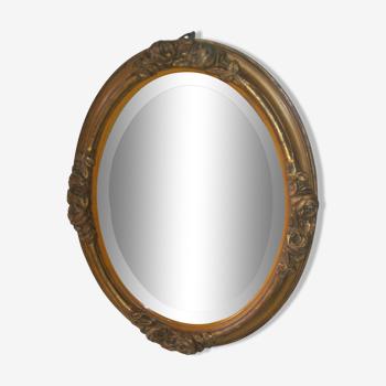 Miroir ovale doré en bois sculpté