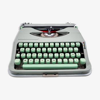 Machine à écrire Hermes Baby Rocket vert tilleul en valise Bleu révisée ruban neuf