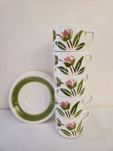 5 cups and ceramic saucers